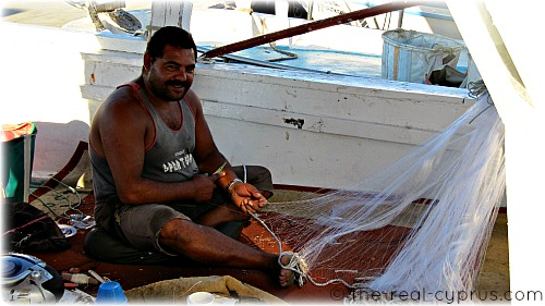 Man Fixing Fishing Nets
